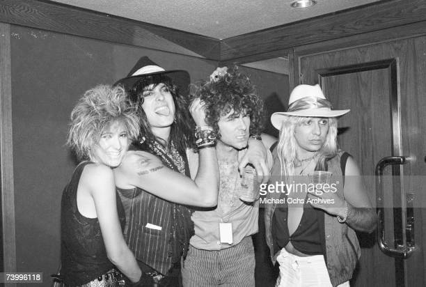 Singer Vince Neil and drummer Tommy Lee of the Heavy Metal Band Motley Crue poses backstage at a Quiet Riot concert at the Forum on September 29 1984...