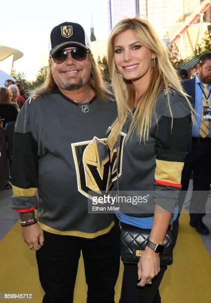 Singer Vince Neil of Motley Crue and makeup artist Rain Hannah arrive at the Golden Knights' inaugural regularseason home opener against the Arizona...
