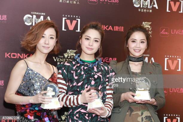 Singer Vincy Chan Gillian Chung and Charlene Choi of girl group Twins pose with their trophies at backstage during the 21st China Music Awards on...