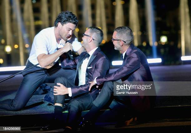 Singer Vittorio Grigolo with Dean and Dan Caten onstage at the gala dinner at the Armani Pavilion during Vogue Fashion Dubai Experience on October 10...