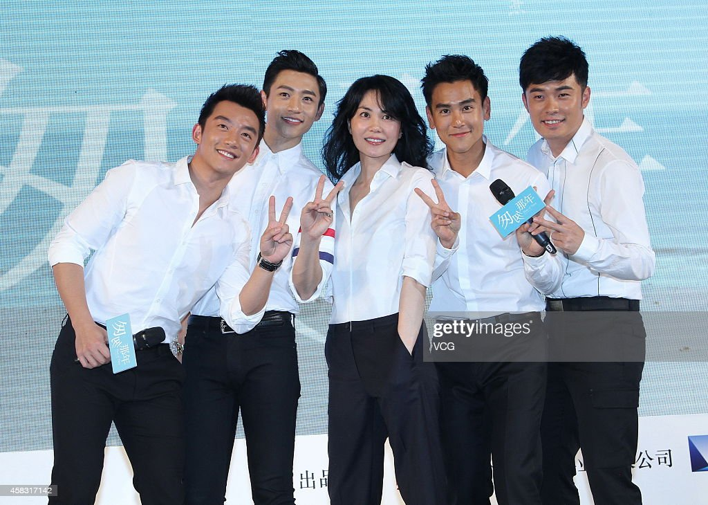 Singer Wang Fei and actor Eddie Peng attend press conference of new movie 'Cling To Old Days' directed by Zhang Yibai on November 3 2014 in Beijing...