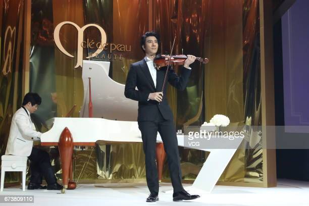 Singer Wang Leehom performs violin during a Cle de Peau Beaute event on April 27 2017 in Shanghai China