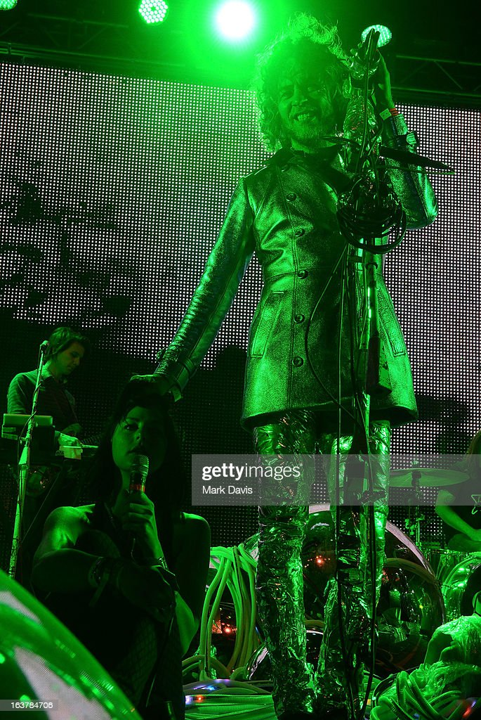 Singer <a gi-track='captionPersonalityLinkClicked' href=/galleries/search?phrase=Wayne+Coyne&family=editorial&specificpeople=204435 ng-click='$event.stopPropagation()'>Wayne Coyne</a> (R) of the Flaming Lips performs at the 2013 SXSW Music, Film + Interactive Festival held at the Auditorium Shores on March 15, 2013 in Austin, Texas.