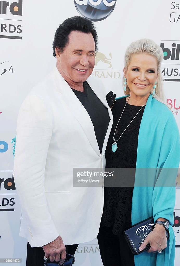 Singer Wayne Newton (L) and Kathleen McCrone arrive at the 2013 Billboard Music Awards at the MGM Grand Garden Arena on May 19, 2013 in Las Vegas, Nevada.