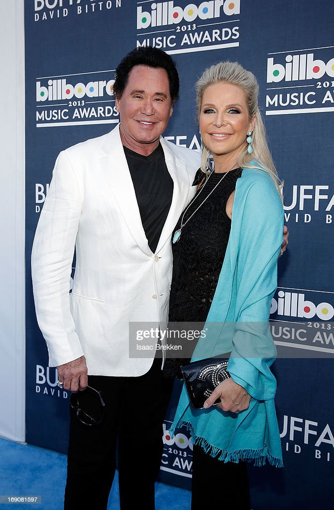 Singer <a gi-track='captionPersonalityLinkClicked' href=/galleries/search?phrase=Wayne+Newton&family=editorial&specificpeople=213441 ng-click='$event.stopPropagation()'>Wayne Newton</a> and Kathleen McCrone arrive at the Buffalo David Bitton red carpet at the 2013 Billboard Music Awards at the MGM Grand Garden Arena on May 19, 2013 in Las Vegas, Nevada.