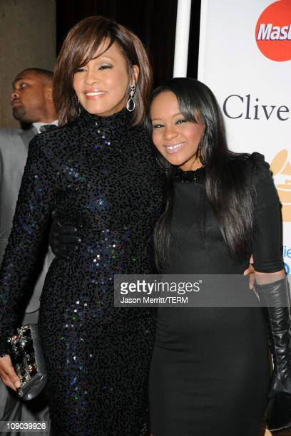 Singer Whitney Houston and Bobbi Kristina Brown arrives at the 2011 PreGRAMMY Gala and Salute To Industry Icons Honoring David Geffen at Beverly...