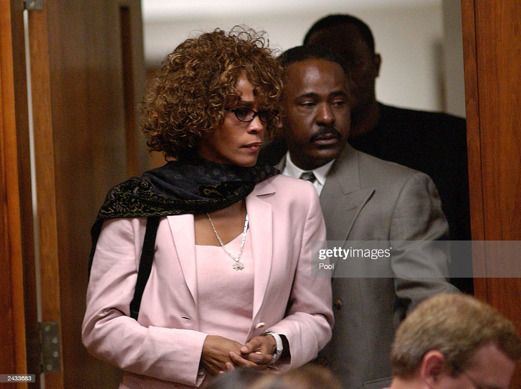 Singer Whitney Houston enters the DeKalb County Courthouse for a probation violation hearing for her husband, singer Bobby Brown August 27, 2003 in Decatur, Georgia. Brown was sentenced to 14 days in the DeKalb County jail followed by 60 days of house arrest for violating conditions of his probation, stemming from 1996 DUI charges.