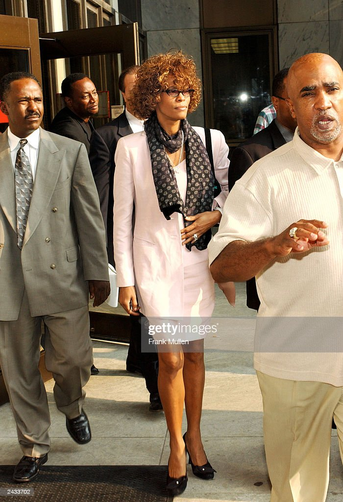 Singer Whitney Houston leaves the DeKalb County Courthouse after a probation violation hearing for her husband, singer Bobby Brown on August 27, 2003 in Decatur, Georgia. Brown was sentenced to 14 days in jail followed by 60 days of house arrest for violating conditions of his probation, stemming from 1996 DUI charges.
