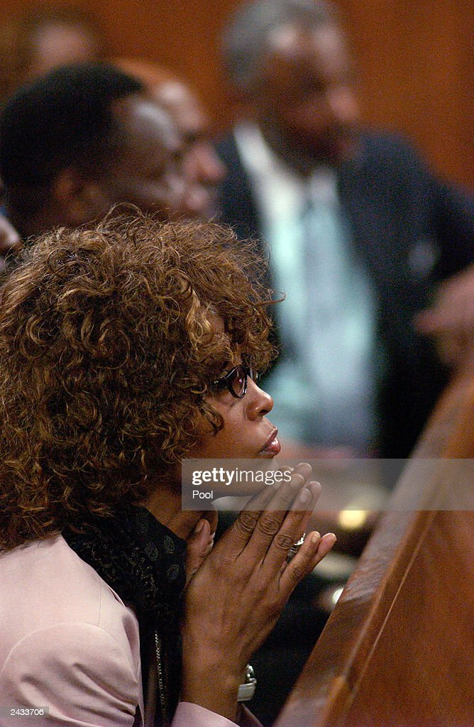 Singer Whitney Houston listens at a probation violation hearing for her husband, singer Bobby Brown at the DeKalb County Courthouse August 27, 2003 in Decatur, Georgia. Brown was sentenced to 14 days in the DeKalb County jail followed by 60 days of house arrest for violating conditions of his probation, stemming from 1996 DUI charges.