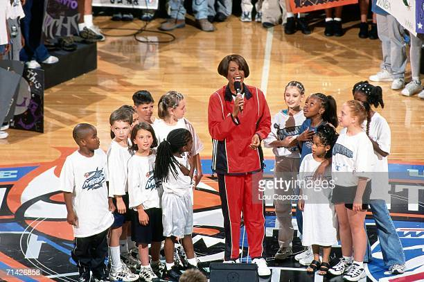 Singer Whitney Houston performs the national anthem at the 1999 WNBA AllStar Game played July 14 1999 at Madison Square Garden in New York New York...