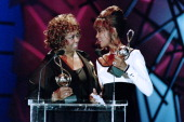 US singer Whitney Houston receives from her mother the World BestSelling Pop Artist of the year award during the 6th World Music Award ceremony in...