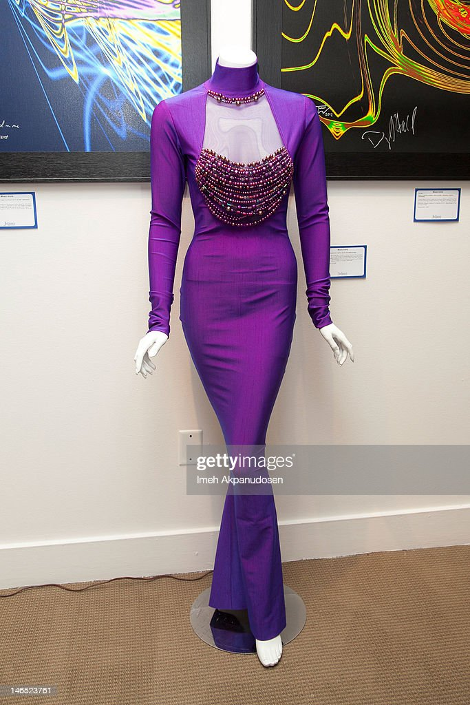 Singer Whitney Houston's purple Marc Bouwer gown on display during the Music Icons And Sports Legends Memorabilia Auction Press Call at Julien's Auctions Gallery on June 18, 2012 in Beverly Hills, California.