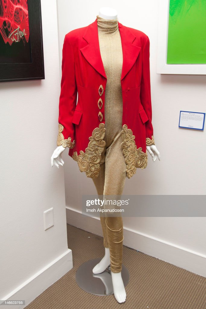 Singer Whitney Houston's red jacket and gold bodysuit on display during the Music Icons And Sports Legends Memorabilia Auction Press Call at Julien's Auctions Gallery on June 18, 2012 in Beverly Hills, California.