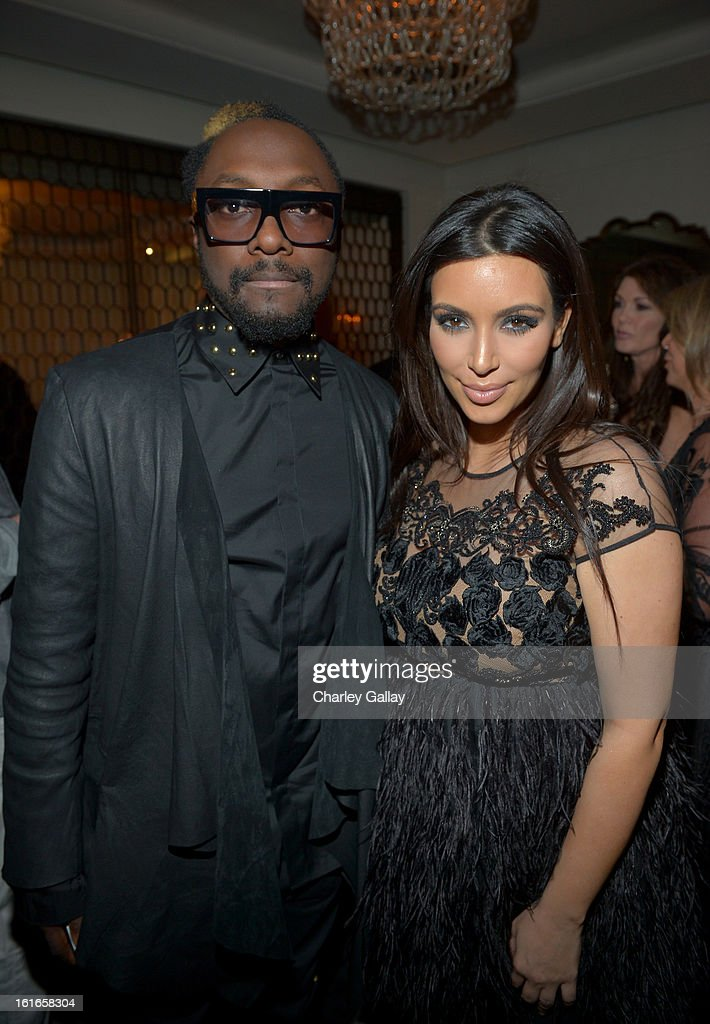 Singer Will.i.am and Kim Kardashian attend the Topshop Topman LA Opening Party at Cecconi's West Hollywood on February 13, 2013 in Los Angeles, California.