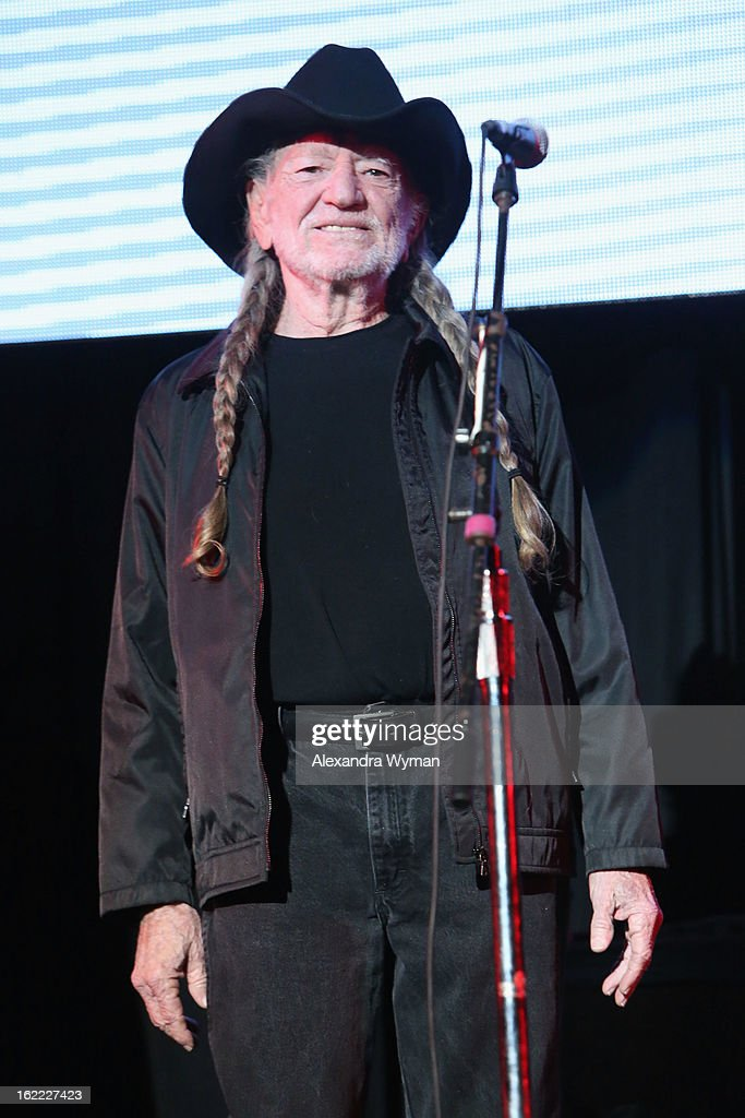 Singer <a gi-track='captionPersonalityLinkClicked' href=/galleries/search?phrase=Willie+Nelson&family=editorial&specificpeople=203154 ng-click='$event.stopPropagation()'>Willie Nelson</a> performs on stage during Global Green USA's 10th Annual Pre-Oscar Party at Avalon on February 20, 2013 in Hollywood, California.