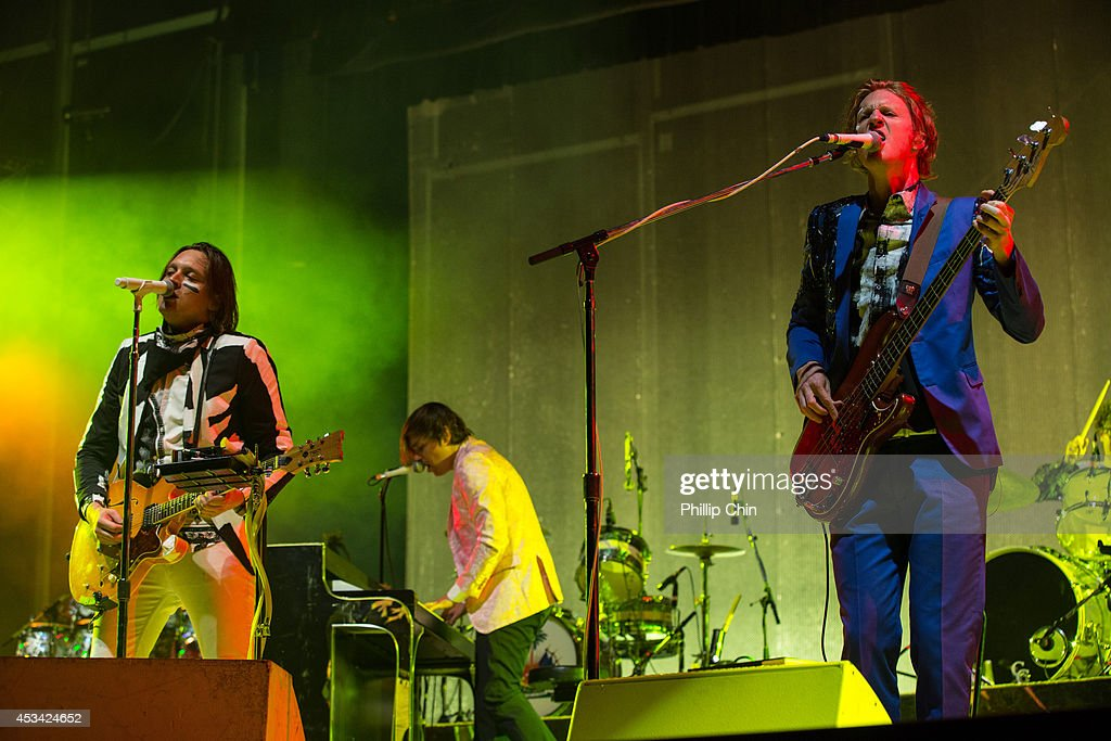 Singer Win Butler, percussionist Will Butler and guitarist Richard Reed Parry of Arcade Fire performs at Squamish Valley Music Festival on August 9, 2014 in Squamish, Canada.