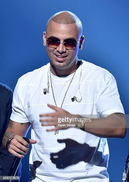 Singer Wisin performs onstage during rehearsals for the 15th annual Latin GRAMMY Awards at the MGM Grand Garden Arena on November 19 2014 in Las...