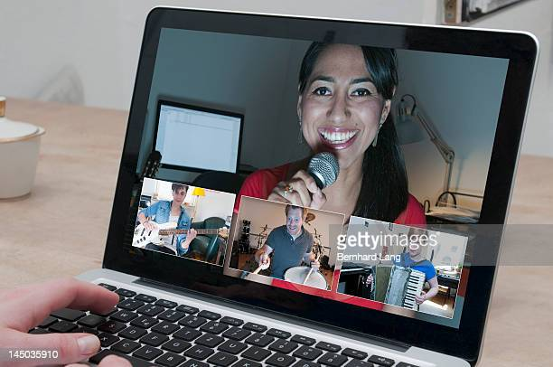 Singer with other musicians performing online