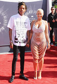 Singer Wiz Khalifa and Amber Rose arrive at the 2014 MTV Video Music Awards at The Forum on August 24 2014 in Inglewood California