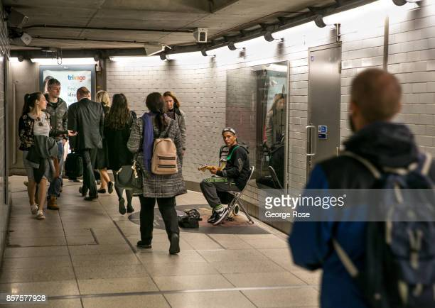 A singer works a pedestrian walkway in the Westminster Underground station on September 13 in London England Great Britain's move toward 'Brexit' or...