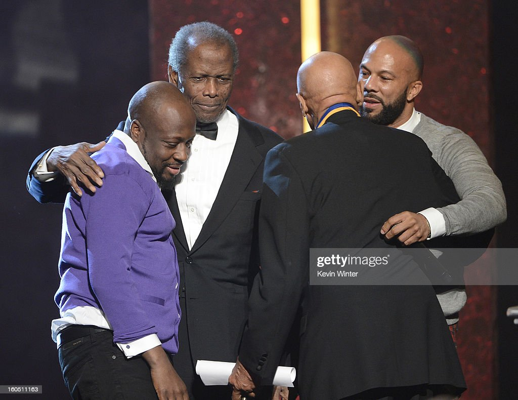 Singer Wyclef Jean, actor Sidney Poitier, Spingarn Medal honoree Harry Belafonte, and rapper-actor Common speak onstage during the 44th NAACP Image Awards at The Shrine Auditorium on February 1, 2013 in Los Angeles, California.