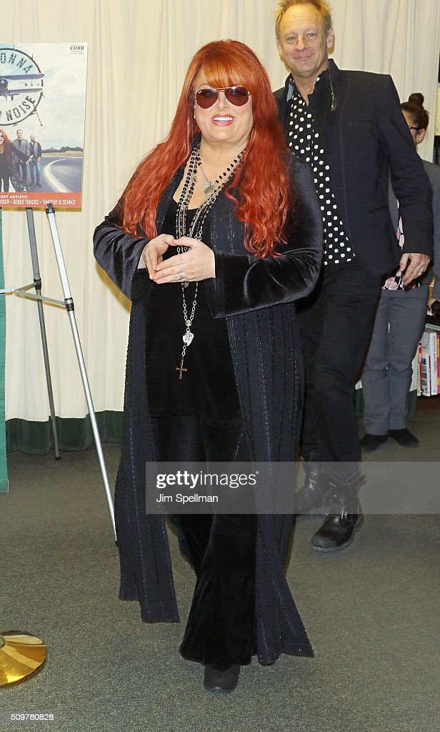 Singer <a gi-track='captionPersonalityLinkClicked' href=/galleries/search?phrase=Wynonna+Judd&family=editorial&specificpeople=212835 ng-click='$event.stopPropagation()'>Wynonna Judd</a> signs copies of 'Wynonna & The Big Noise' at Barnes & Noble, 5th Avenue on February 12, 2016 in New York, New York.