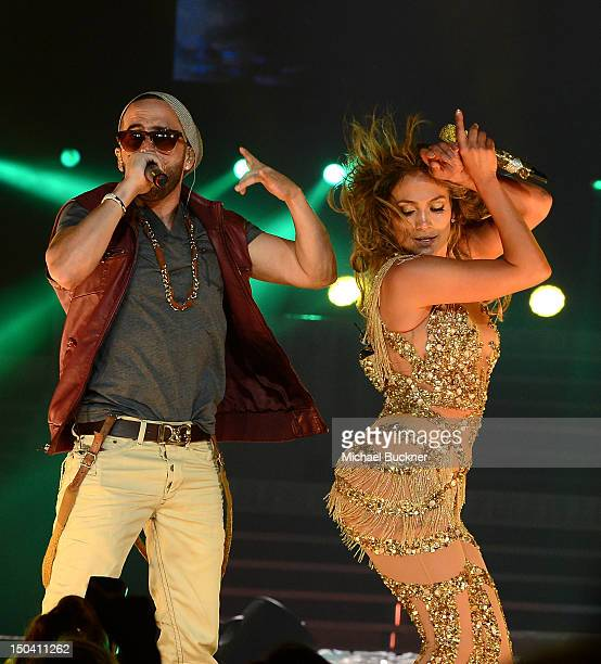 Singer Yandel and singer Jennifer Lopez and Atlantico Rum celebrate the Los Angeles show at Staples Center on August 16 2012 in Los Angeles California