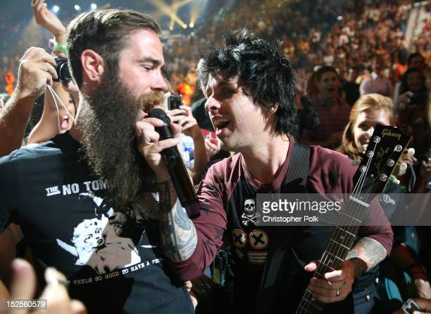 Singer Zabi Naqshband sings with frontman Billie Joe Armstrong of Green Day during the 2012 iHeartRadio Music Festival at the MGM Grand Garden Arena...