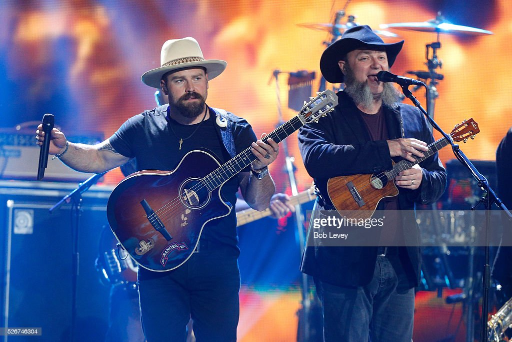 Singer Zac Brown (L) and John Driskell Hopkins of Zac Brown Band perform onstage during the 2016 iHeartCountry Festival at The Frank Erwin Center on April 30, 2016 in Austin, Texas.