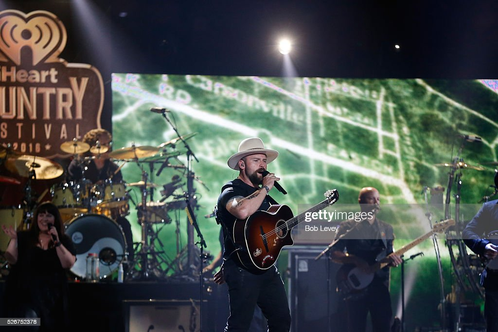 Singer Zac Brown (C) performs onstage during the 2016 iHeartCountry Festival at The Frank Erwin Center on April 30, 2016 in Austin, Texas.