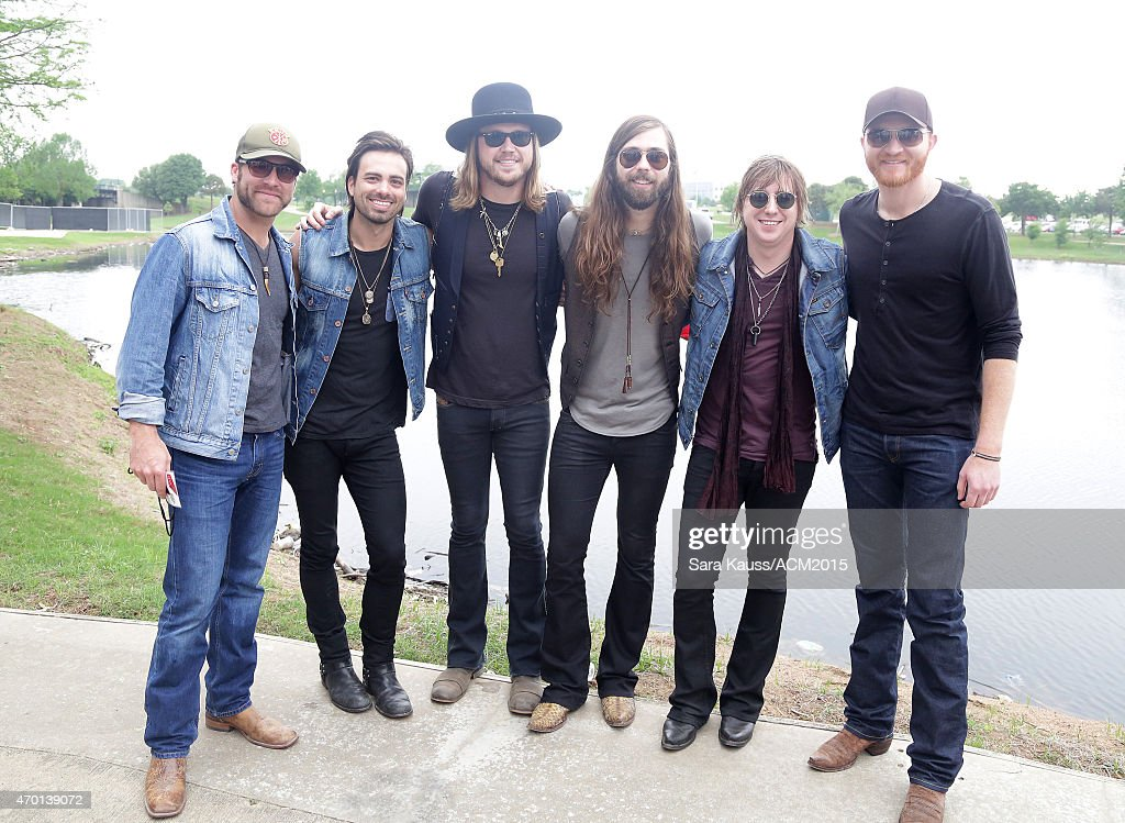 Singer Zach Brown Michael Hobby Graham Deloach and Bill Satcher of A Thousand Horses and Eric Paslay attend the ACM Party For A Cause Festival at...