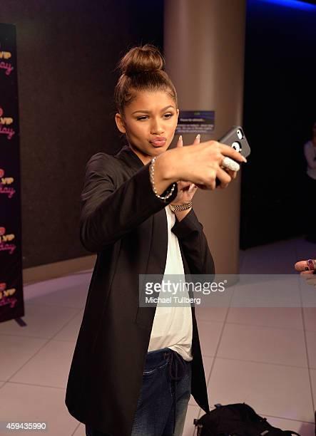 Singer Zendaya takes a selfie at Radio Disney's Family VIP Birthday event celebrating 18 years of Radio Disney at Club Nokia on November 22 2014 in...