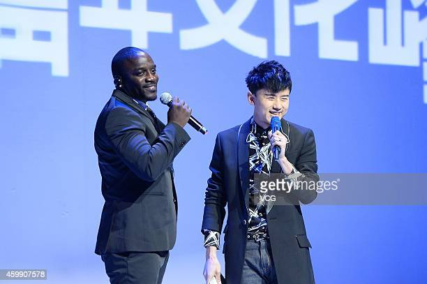 Singer Zhang Jie and singer Akon attend the first 'Global Youth Culture Summit' held by EEMedia at DAD£­Dashanzi Art District on December 3 2014 in...