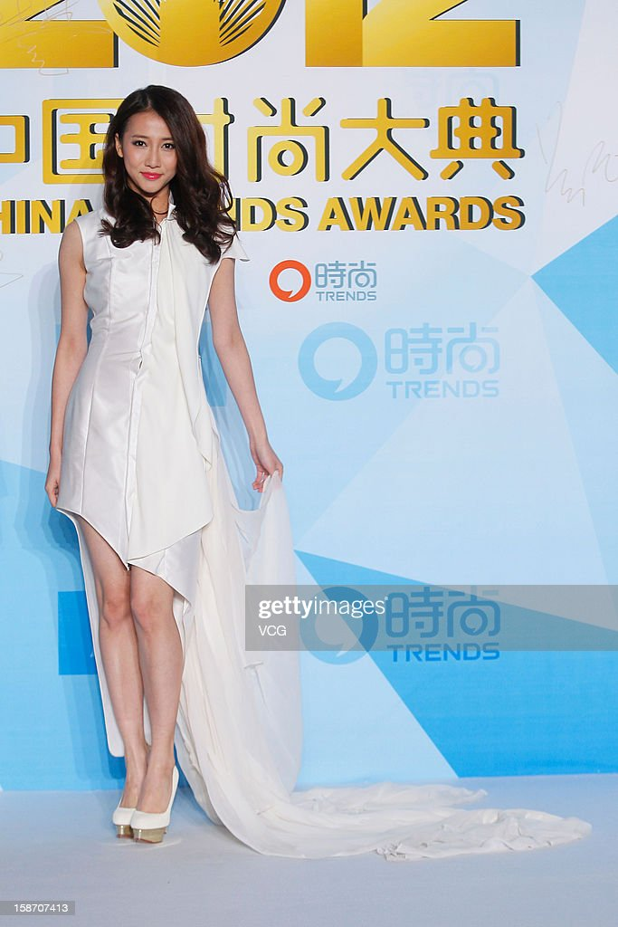 Singer Zhang Xianzi arrives at the red carpet of the 2012 China Trends Awards at BTV Grand Theater on December 22, 2012 in Beijing, China.