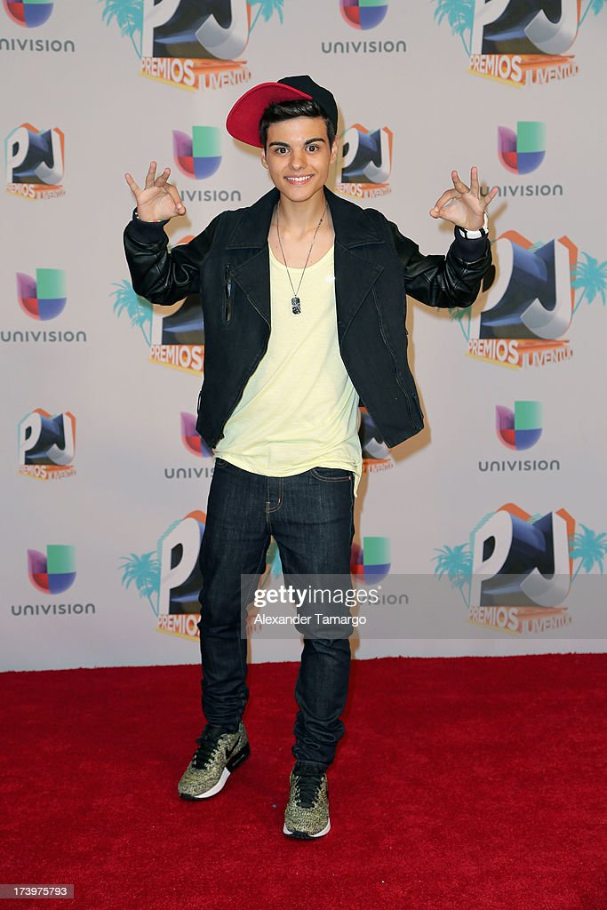 Singer-actor <a gi-track='captionPersonalityLinkClicked' href=/galleries/search?phrase=Abraham+Mateo&family=editorial&specificpeople=11160528 ng-click='$event.stopPropagation()'>Abraham Mateo</a> poses in the press room during the Premios Juventud 2013 at Bank United Center on July 18, 2013 in Miami, Florida.