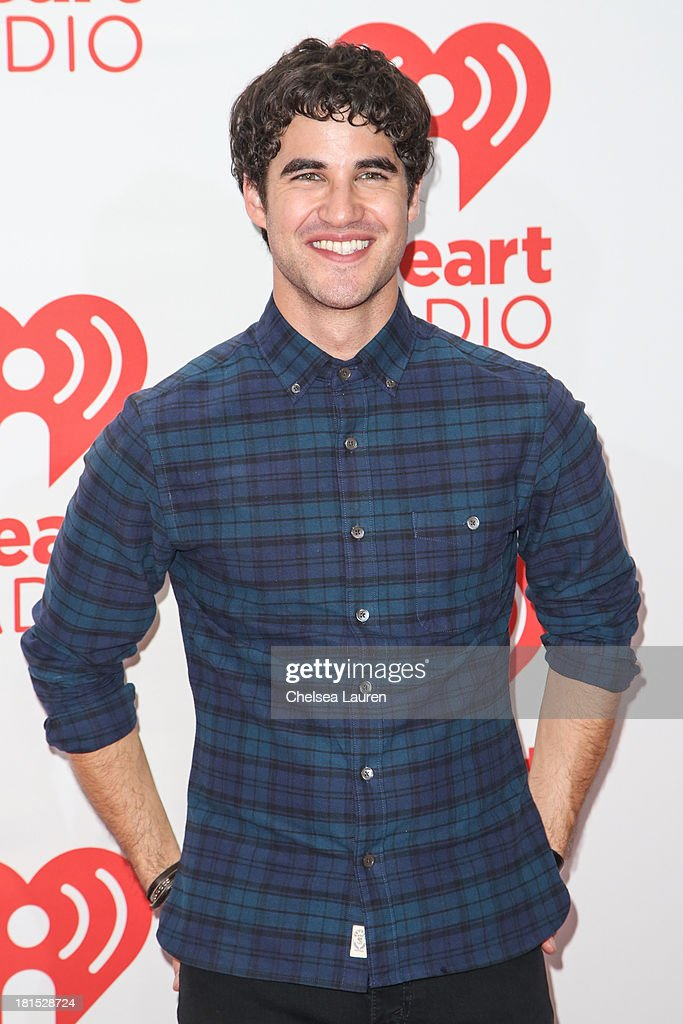 Singer/actor Darren Criss poses in the iHeartRadio music festival photo room on September 21, 2013 in Las Vegas, Nevada.