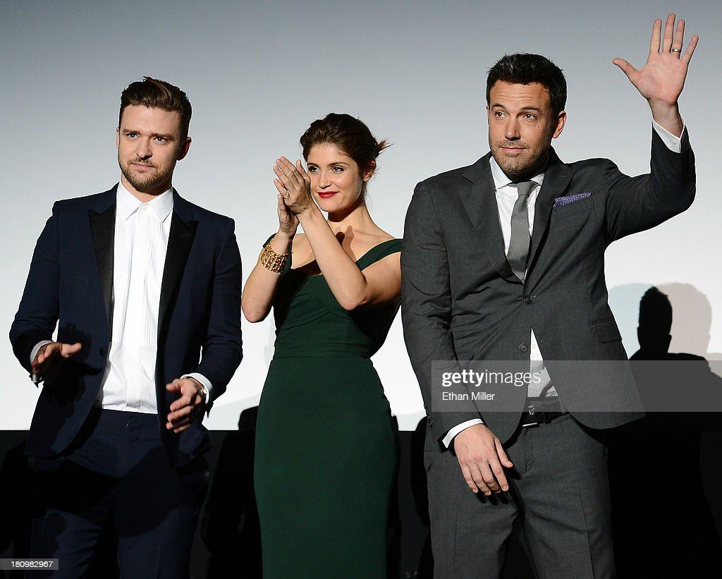 Singer/actor Justin Timberlake, actress Gemma Arterton and actor/director Ben Affleck introduce the world premiere of Twentieth Century Fox and New Regency's film 'Runner Runner' at Planet Hollywood Resort & Casino on September 18, 2013 in Las Vegas, Nevada.