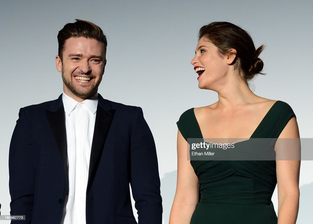 Singer/actor Justin Timberlake (L) and actress Gemma Arterton laugh as they introduce the world premiere of Twentieth Century Fox and New Regency's film 'Runner Runner' at Planet Hollywood Resort & Casino on September 18, 2013 in Las Vegas, Nevada.