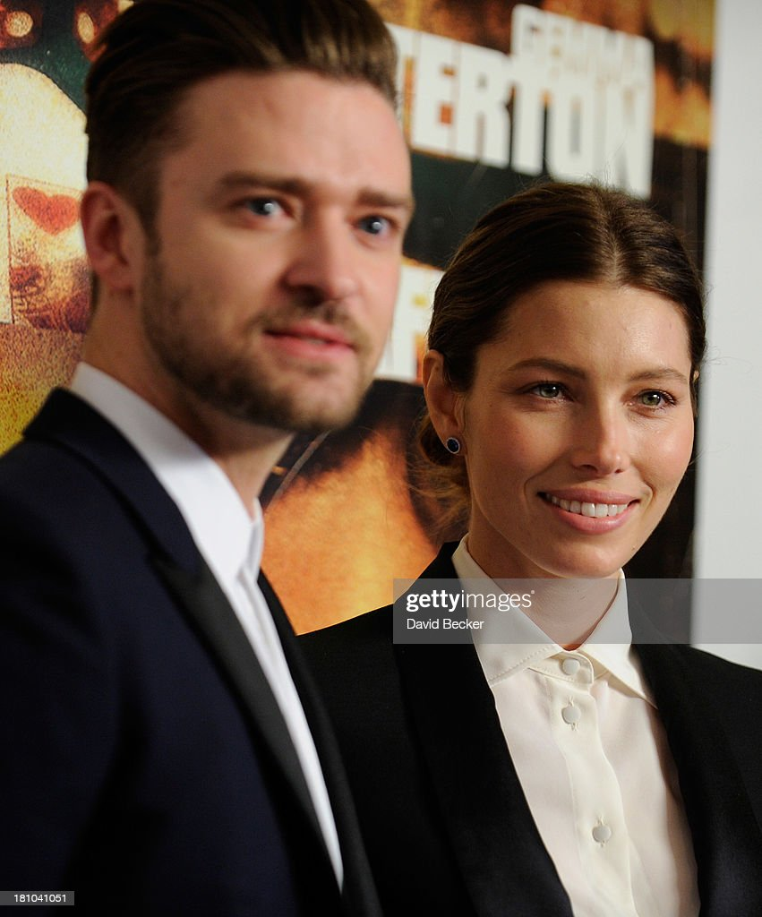 Singer/actor Justin Timberlake (L) and his wife, actress Jessica Biel, arrive at the world premiere of Twentieth Century Fox and New Regency's film 'Runner Runner' at Planet Hollywood Resort & Casino on September 18, 2013 in Las Vegas, Nevada.