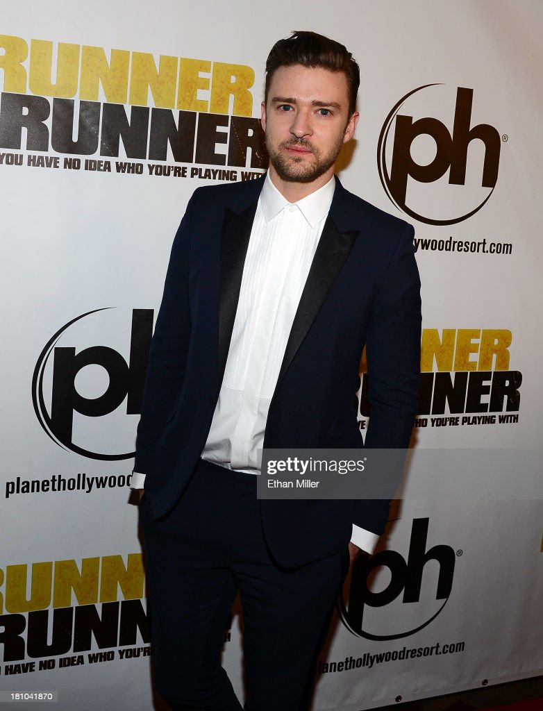 Singer/actor Justin Timberlake arrives at the world premiere of Twentieth Century Fox and New Regency's film 'Runner Runner' at Planet Hollywood...