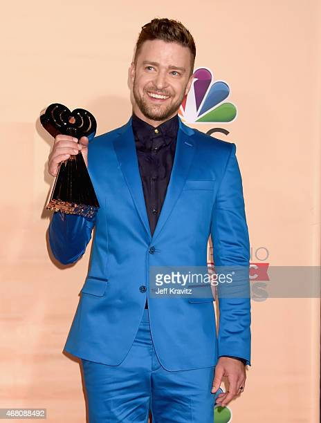 Singer/actor Justin Timberlake poses with an award in the press room at the 2015 iHeartRadio Music Awards which broadcasted live on NBC from The...