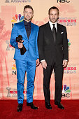 Singer/actor Justin Timberlake winner of the iHeartRadio Innovator Award poses with designer Tom Ford in the press room during the 2015 iHeartRadio...