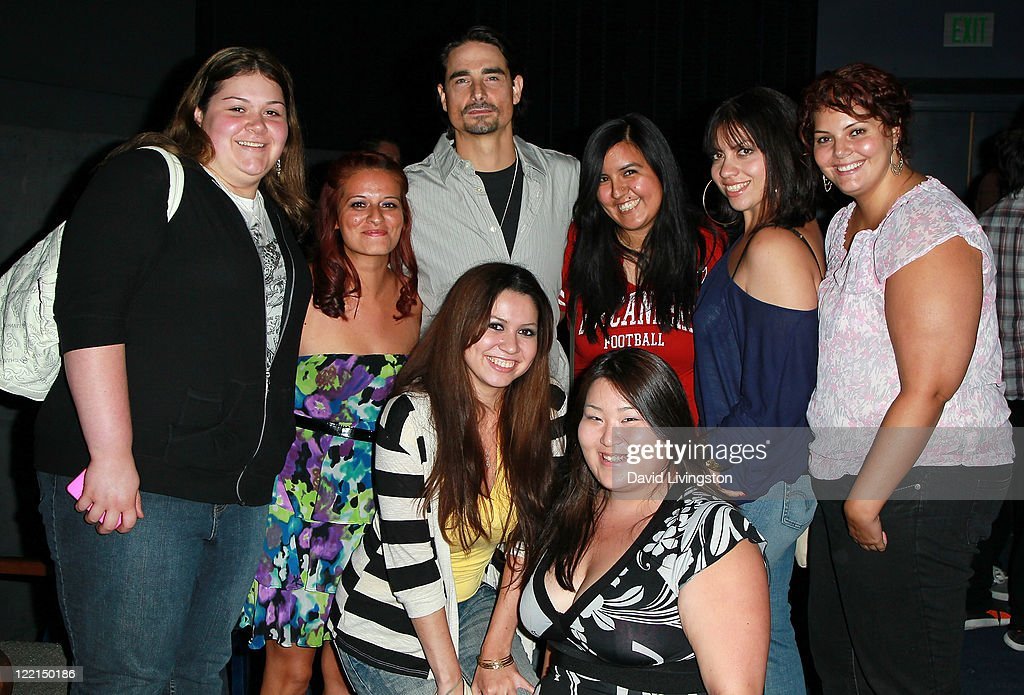 Singer/actor Kevin Richardson (C, rear) and fans attend the Los Angeles premiere of 'The Casserole Club' presented by the American Cinematheque at the Egyptian Theatre on August 25, 2011 in Hollywood, California.