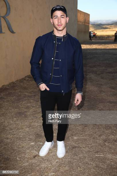 Singer/actor Nick Jonas attends the Christian Dior Cruise 2018 Runway Show at the Upper Las Virgenes Canyon Open Space Preserve on May 11 2017 in...