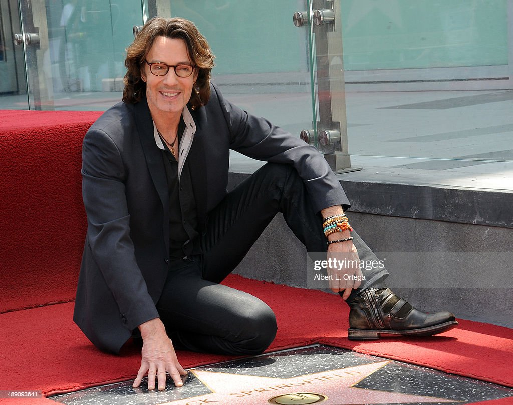 Singer/actor <a gi-track='captionPersonalityLinkClicked' href=/galleries/search?phrase=Rick+Springfield&family=editorial&specificpeople=242775 ng-click='$event.stopPropagation()'>Rick Springfield</a> honored with a Star On The Hollywood Walk Of Fame on May 9, 2014 in Hollywood, California.
