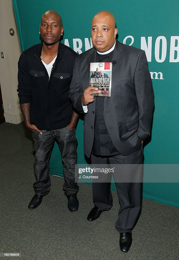 Singer/actor Tyrese Gibson and rapper/reality television personaility Rev Run pose with copies of their new book 'Manology: Secrets of a Man's Mind Revealed' during a book signing at Barnes & Noble Union Square on February 5, 2013 in New York City.