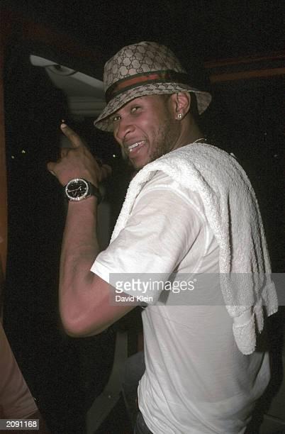 Singer/Actor Usher poses at Joseph's Club June 16 2003 in Hollywood California