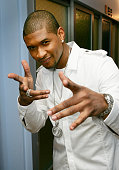 Singer/actor Usher Raymond poses backstage at MTV's Total Request Live at MTV's Time Square Studios November 22 2005 in New York City