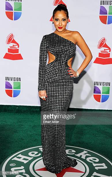 Singer/actress Adrienne Bailon arrives at the 12th annual Latin GRAMMY Awards at the Mandalay Bay Resort Casino on November 10 2011 in Las Vegas...