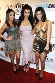 SInger/actress Adrienne Bailon TV personality Kim Kardashian and TV personality Kourtney Kardashian attend the 6th Annual Leather and Laces...